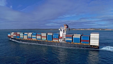 Container ship with containers on fire returned to port